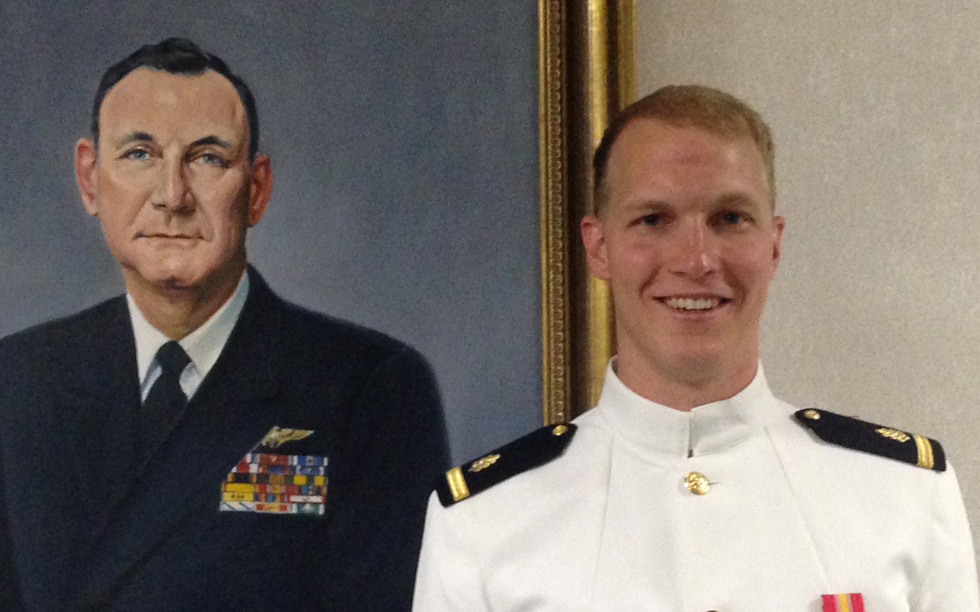 Hunt Hardisty next to a portrait of Admiral Huntington Hardisty at the Naval War College in Newport, Rhode Island.