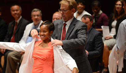 Student receiving a white coat
