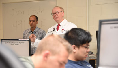 Dean Hess in a classroom